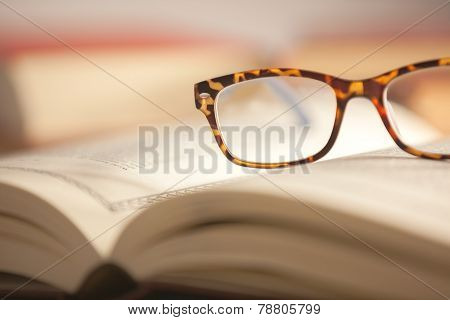 Glasses Are Laying On A Book