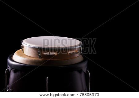 Tambourine Laying On A Bongo Drum