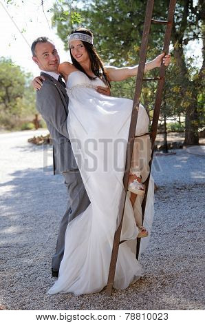 Groom And Bride Fun Climbing A Rusty Ladder