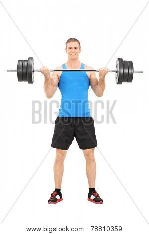 Full length portrait of a male bodybuilding lifting a barbell isolated on white background