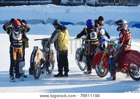 NOVOSIBIRSK, RUSSIA - DECEMBER 20, 2014: Unidentified bikers before the semi-final individual rides of Russian Ice Speedway Championship. The sports returns to the sport arenas after a decline