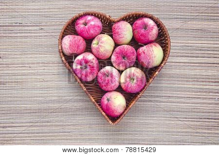 Fresh Apples In Wicker Wooden Heart Form Basket