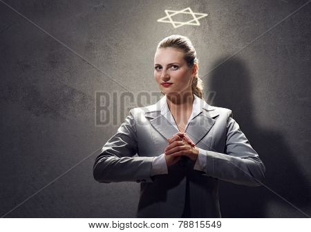 Praying businesswoman