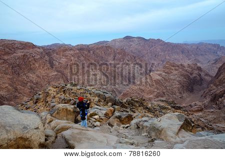 Egypt, Sinai Mountains, Girl Photographs The Morning View