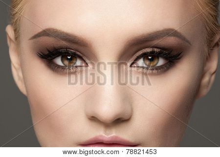 Closeup image of beautiful woman eyes with fancy bright makeup.