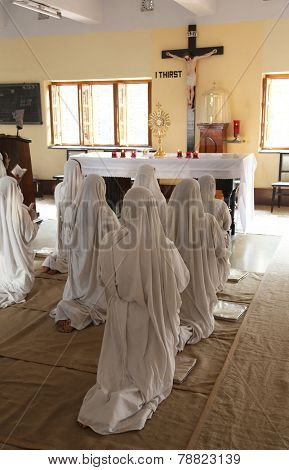 KOLKATA, INDIA - FEBRUARY 08: Sisters of Mother Teresa's Missionaries of Charity in prayer in the chapel of the Mother House, Kolkata, India at February 08, 2014.