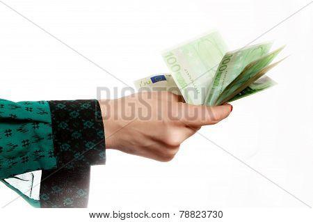 Woman holding euro banknotes