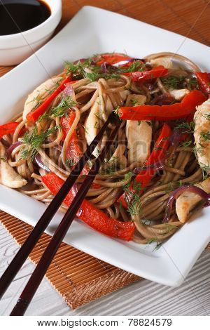 Yakisoba With Chicken, Vegetables And Teriyaki Sauce. Vertical