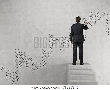 Businessman Drawing  Tic Tac Toe Graph