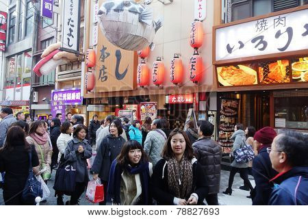 Unidentified Customers Queue To Buy Takoyaki In Osaka On December13, 2014.