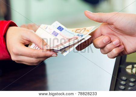 Woman Customer Paying With Money. Hands Detail.