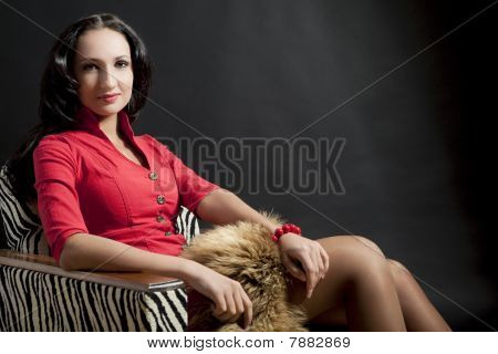 Lady In Striped Chair