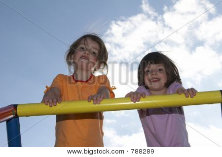 twins on climbing pole 02