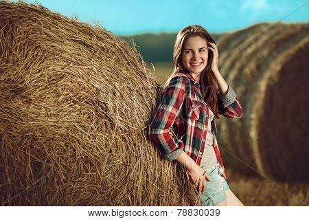 Girl Next To Haystack