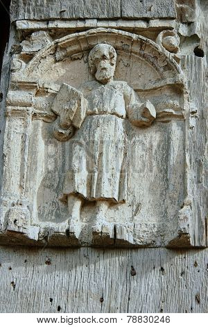 Wooden sculpture on medieval building