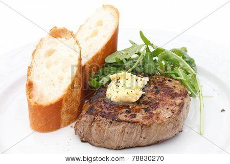 Perfect roast pork tenderloin fillet steak topped with melting butter