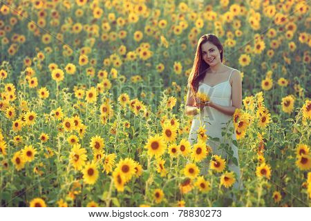 Young Woman With Sunflowers