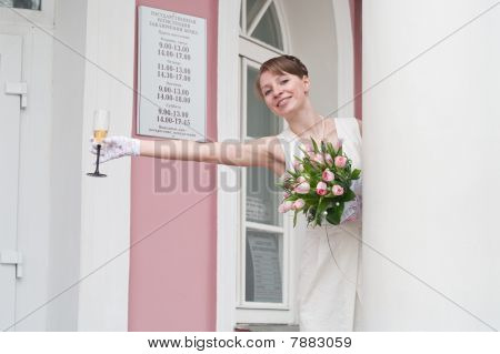 Woman A Bride With Glass Of Wine Near A Registry Office Buildings. Table Is Hours Of Operation