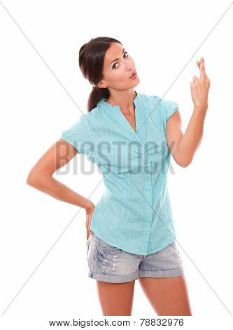 Attractive Latin Girl Making A Wish Sign