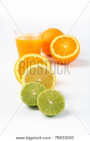 Orange juice and slices of orange and lemonade isolated on white