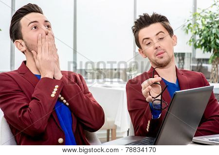 Two brothers twins working at the office