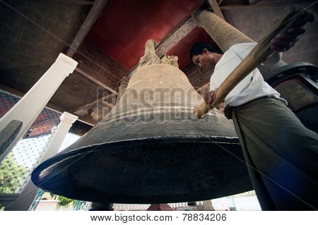 Man Hitting The Mingun Bell In Myanmar.