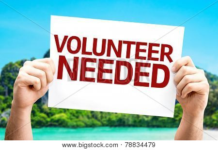 Volunteer Needed card with a beach on background
