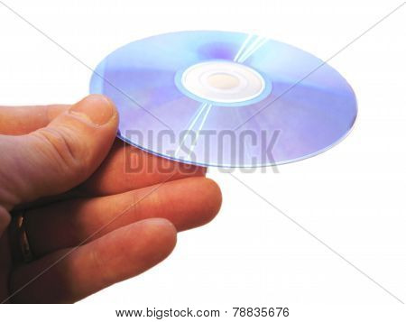 Mans Hand Holding Compact Disc On The Finger Isolated