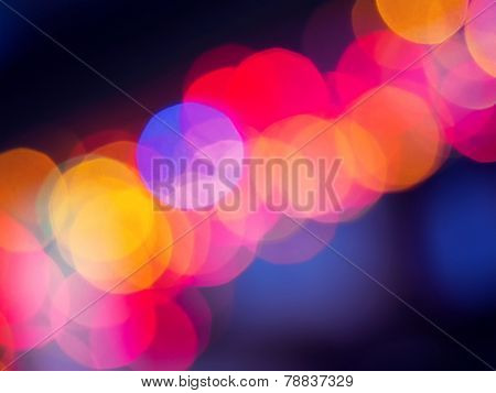 Colorful bokeh on a dark background. Defocused bokeh lignts. Abstract Christmas batskground. Abstrac