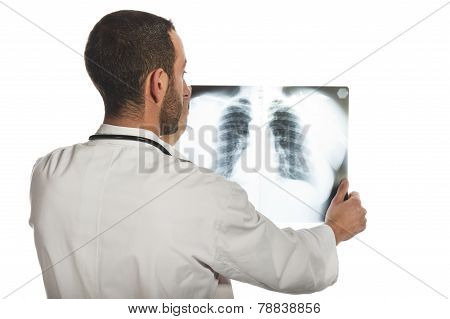 male doctor looking at the x-ray picture