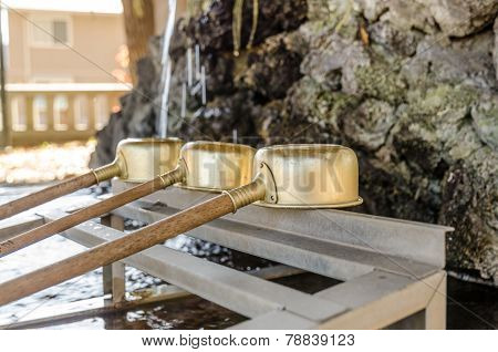 Brass Dipper Arranged In Front Of Purification Trough In Shinto Shrines And Buddhist Temple, Japan