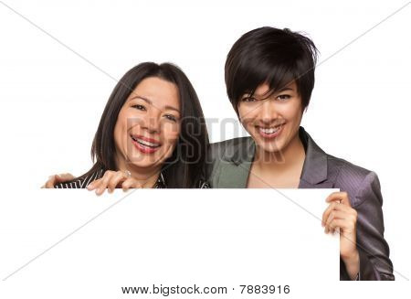Attractive Multiethnic Mother And Daughter Holding Blank White Sign