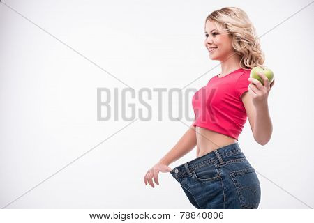 Full-length portrait of attractive slim young smiling woman in b