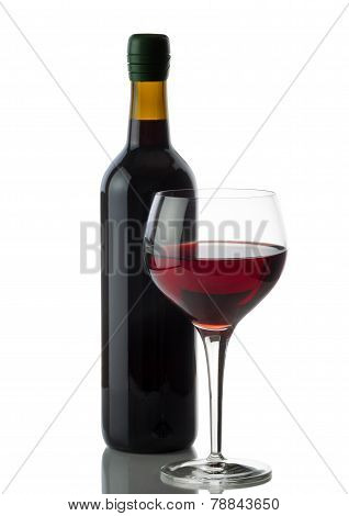 Glass Of Red Wine With Full Bottle On White Background