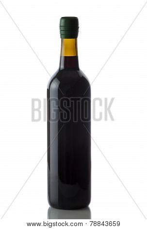 Unopened Bottle Of Red Wine With Green Cap On White