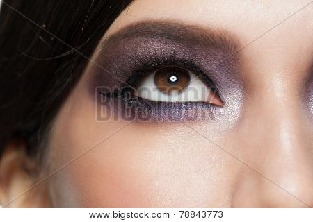 Closeup image of beautiful woman eye with bright makeup. Makeup with eyeliner, macro.