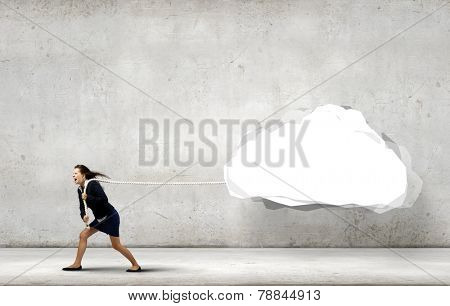 Young businesswoman pulling white cloud with rope