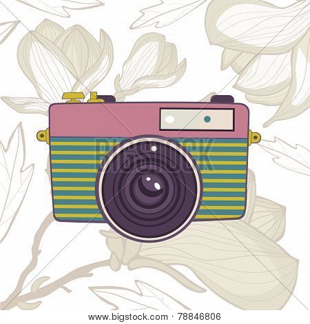 Elegant vintage camera on floral background