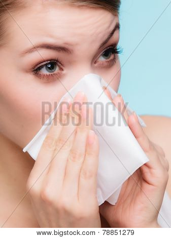 Sick Girl With Flu or Allergy Sneezing In Tissue