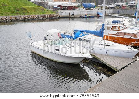 image of motor boat stand at a berth