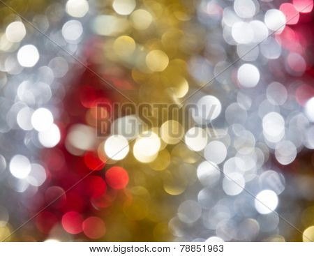 Shiny gold, silver and red bokeh background