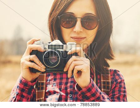Smiling Girl Takes Photographs With Vintage Photo Camera