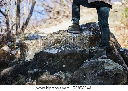Hiker Woman Go Up On Rock, View Of Legs