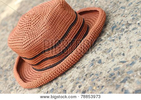 Brown Hat On A Background Of Cement.