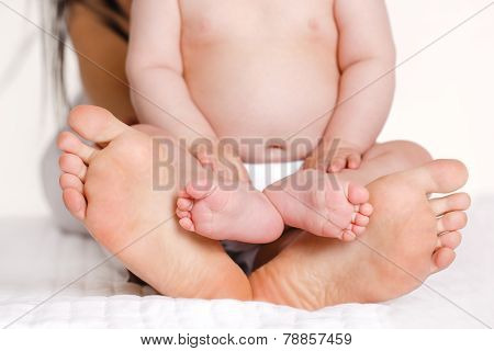 Children's and adult foot of feet.