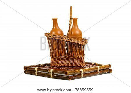 Basket With Ceramic Wine Bottles