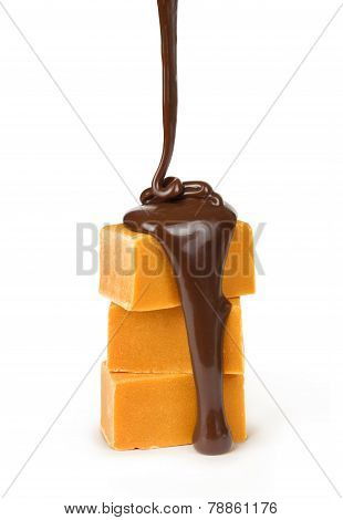 with a piece of caramel dripping chocolate on a white background isolation