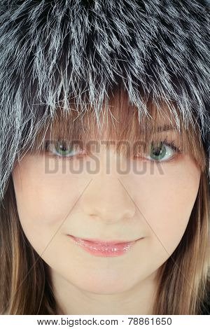 Fashion Female In Fur Hat Close Up