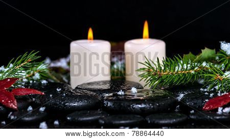 Winter Spa Concept Of Evergreen Branches With Drops, Snow,  Candles On Zen Basalt Stones, Closeup