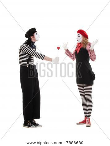 Man Giving Small Red Heart To Woman